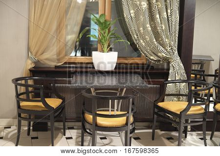 Moscow, Russia - September, 19, 2016: interior of a cafe with table near the window