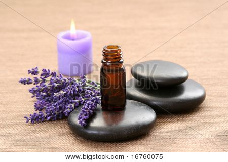 lavender flower black pebbles and lavender oil - spa treatment