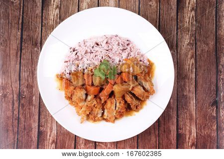 Brown Rice With Chicken Topped Japanese Yellow Curry.