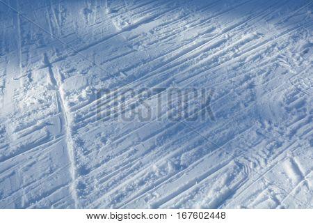 Ski track. Snow skiing flattened. Winter background