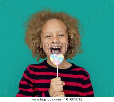 Little Boy Eating Lollipop Candy
