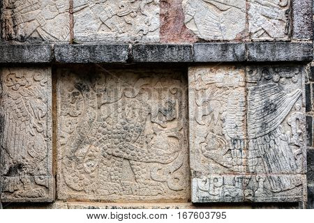 Ancient Mayan murals depicting jaguars and eagles grasping human hearts on the Platform of the Eagles and the Jaguars at Chichen Itza Yucatan Mexico poster