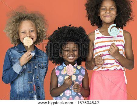 Little Children Eating Lollipop Candy Smile