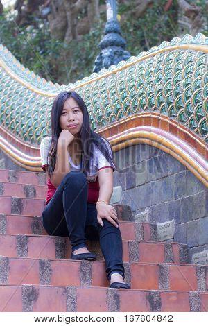 Asian woman with naga staircase, Doi suthep Chiangmai Thailand.