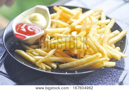 French fries dish or fried potato on the table