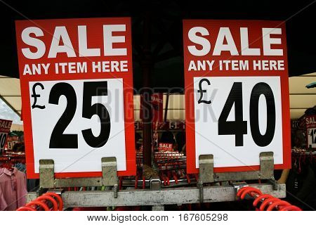 2 sale signs in a clothing area