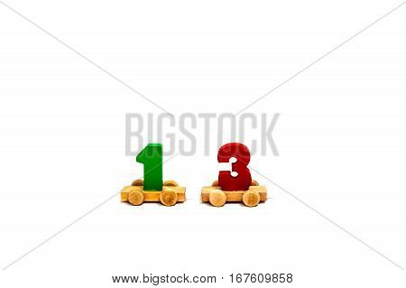 Colorful wooden toy unlucky number on white background