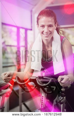 Portrait of happy woman working out at spinning class