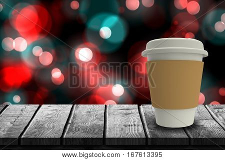 Digitally generated image of disposable cup against digitally generated twinkling light design 3d