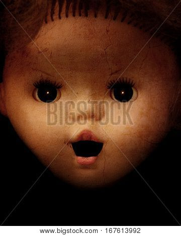 Grunge background with vintage evil spooky doll face and stucco texture