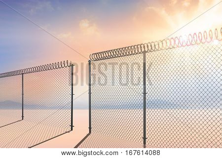 Chainlink fence against white background against desert landscape 3d