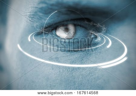Digitally generated image of earth with social connectivity and light trail against close up of man with blue eye