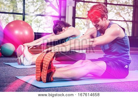 Man and woman performing fitness exercise at gym