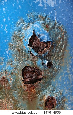 Corroded steel painted blue, bubbles of rust