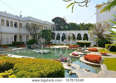 UDAIPUR INDIA - JANUARY 13 2017: Taj Lake Palace Hotel courtyard. One of the most recognizable residences in the world was featured in the film Octopussy.