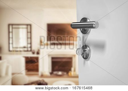 Closeup of doorknob and lock with key against view of living room