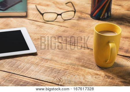 Home desktop with tablet coffee cup notepad and pencil with copy space