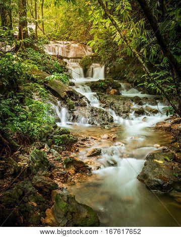 Waterfall In Deep Tropical Jungle.