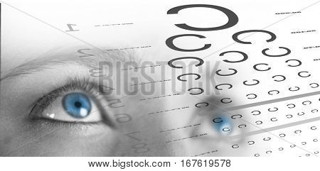 eye test against close up of woman with brown eyes