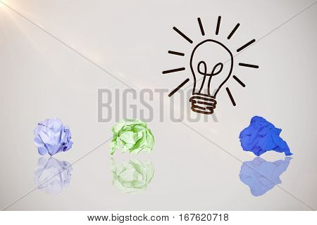 Digital image of blank purple crumpled paper against idea and innovation graphic