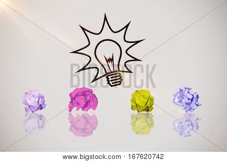 Digital image of crumpled paper ball against idea and innovation graphic