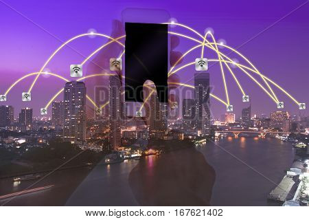 business conection concept on cityscape background and hand hold telephone