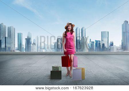 Young Asian Woman Wearing Hat Holding Shopping Bags