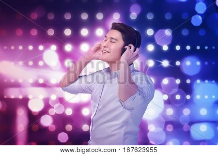 Young Asian Man Listening Music Headphones With Relax