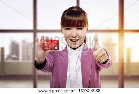 Beautiful Asian Business Woman Give Thumbs And Showing Credit Card