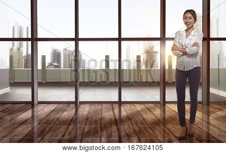 Beautiful Asian Business Woman With Folded Arms