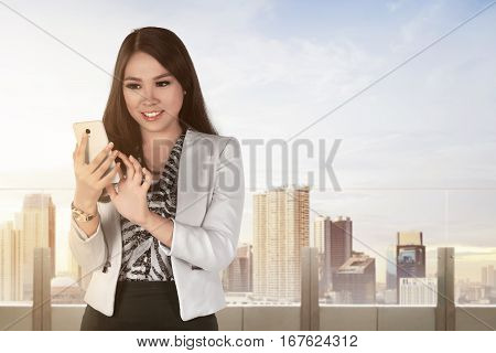 Young Asian Business Woman With A Smartphone