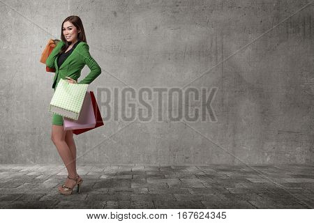 Smiling Asian Business Woman With Shopping Bags