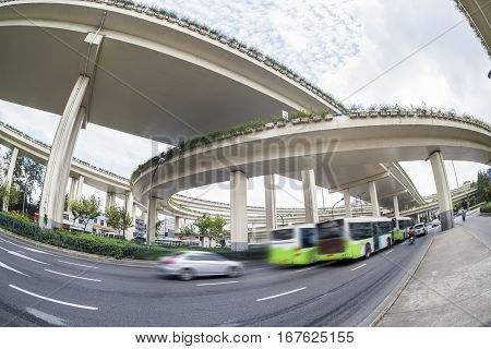 city overpasses and vehicles motion blur fisheye view