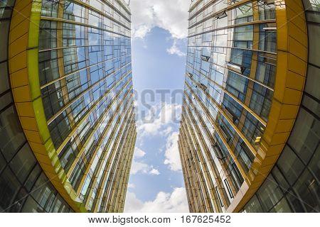 upward view of modern glass buildings fisheye view