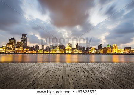 shanghai bund with sunset glow wooden floor as a prospect