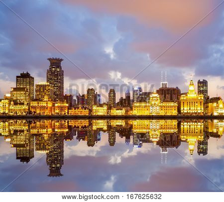 beautiful shanghai bund with reflection in sunset China