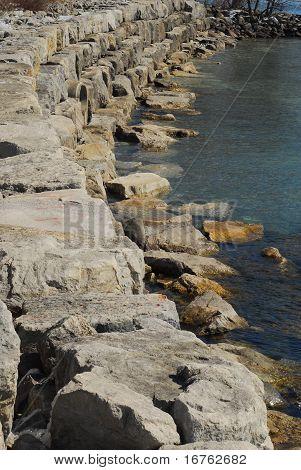 Stone Breakwall On Lake