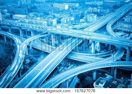 city overpass closeup with blue tone expressway interchange and viaducts in hangzhou