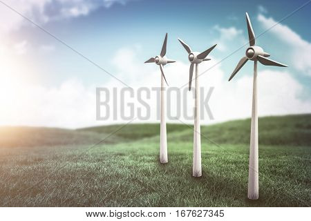 Wind turbines against white screen against green field under blue sky 3d