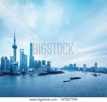 shanghai skyline and huangpu river view with blue tone