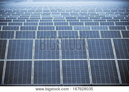 solar energy closeup large area photovoltaic panels with blue tone