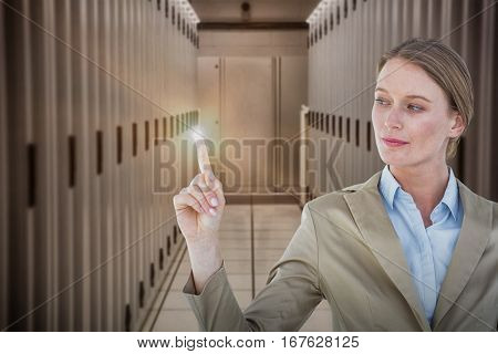 Businesswoman pointing with her finger against data center