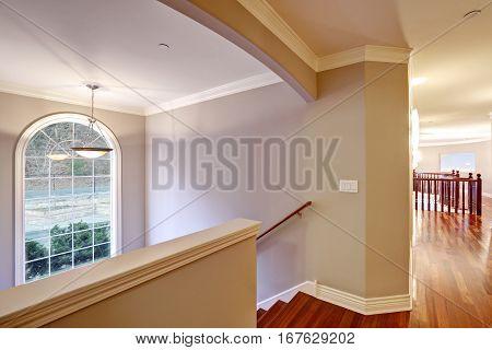Second Floor Landing With Polished Hardwood Floor