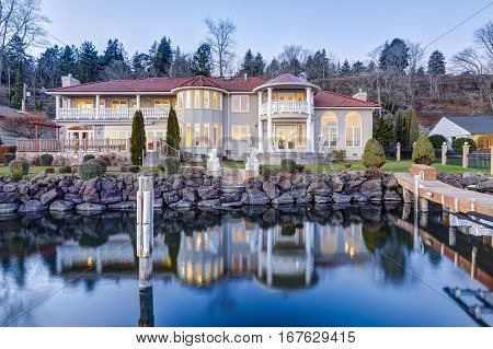 Luxurious Waterfront Home Exterior. View From The Deck.