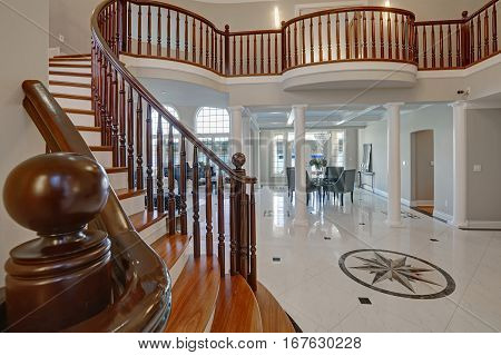 Stunning High Ceiling Entry Foyer With Marble Mosaic Tiled Floor