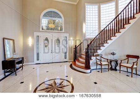 Stunning Two Story Entry Foyer With Marble Mosaic Tiled Floor