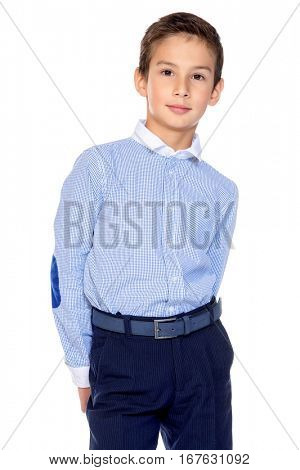 Portrait of a smiling nine year old boy in classic shirt and trousers. Kid's fashion. Educational concept. Isolated over white background. Copy space.