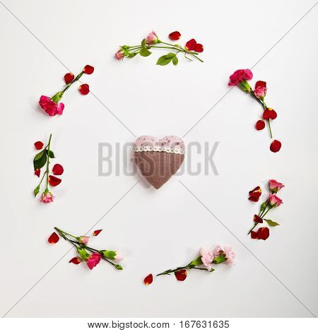 Love Concept - Creative Valentines Day Background with Natural Flower Frame and Heart. Wedding Day. Minimal Love Concept. Top View. Flat Lay