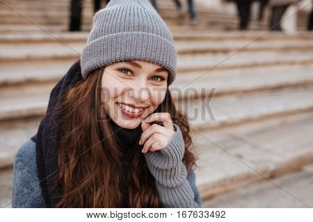 Portrait of happy beautiful young woman on the street in autumn