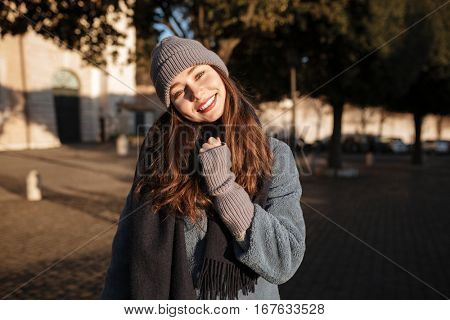 Portrait of smiling beautiful young woman standing in the city